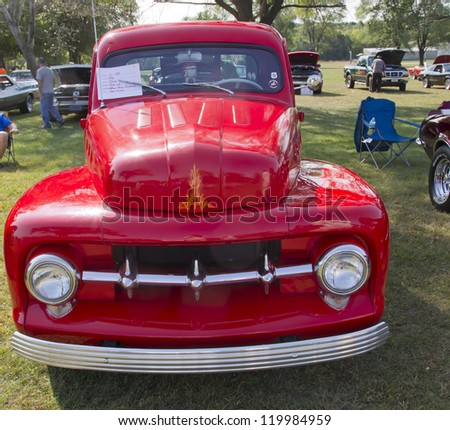 MARION, WI - SEPTEMBER 16: Front of 1952 Red Ford Pickup Truck at the 3rd Annual Not Just Another Car Show on September 16, 2012 in Marion, Wisconsin. - stock photo