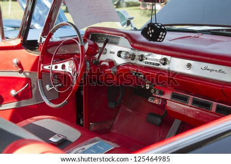 MARION, WI - SEPTEMBER 16: Interior of 1958 black Chevy Impala car at the 3rd Annual Not Just Another Car Show on September 16, 2012 in Marion, Wisconsin. - stock photo