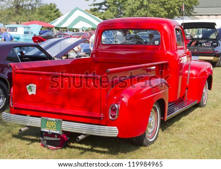 MARION, WI - SEPTEMBER 16: 1952 Red Ford Pickup Truck at the 3rd Annual Not Just Another Car Show on September 16, 2012 in Marion, Wisconsin. - stock photo