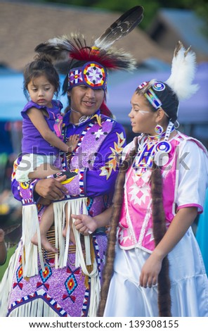 MARIPOSA ,USA - MAY 11 : An unidentified Native Indian family takes part at the Mariposa 20th annual Pow Wow in California , USA on May 11 2013 ,Pow wow is native American cultural gathernig event. - stock photo