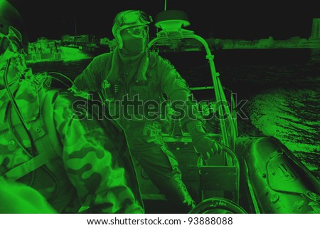 Maritime commando – soldier. The Marine special forces to enter the ship to its search and hostage rescue – exercises. On the action. View from night vision. - stock photo