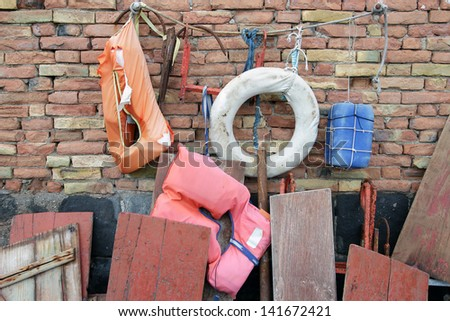 maritime equipment, hanging on a wall