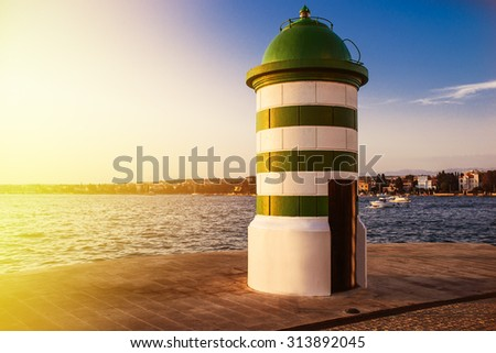 Maritime lighthouse in Zadar in Croatia situated on the Adriatic Sea. - stock photo