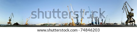 Maritime Terminal, panoramic .Cranes in a port. - stock photo