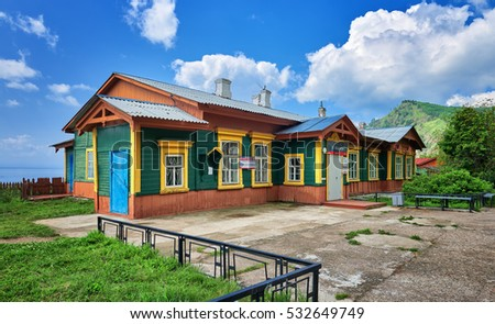 MARITUI. IRKUTSK REGION, RUSSIA - July, 29,2016: Building Maritui station Circum-Baikal Railway. Old wooden structure and concrete area in front of structure