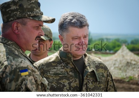 Mariupol, Ukraine - Jun 11, 2015. President of Ukraine, Supreme Commander of Armed Forces of Ukraine Petro Poroshenko examines the construction of fortifications near the Mariupol.