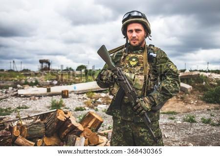 MARIUPOL, UKRAINE June 27, 2015: Ukrainian soldier from the territorial battalion at his post - stock photo