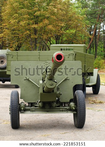 MARIUPOL, UKRAINE-SEPT 9:Soviet 76mm cannon gan ZiS3 and army truck ZiS5,(Ural) taken closeup,historical reenactment of WWII, September 9, 2013 in Mariupol,Ukraine - stock photo