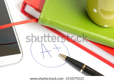Mark A+, stacked books and pen. Graduation success concept - stock photo