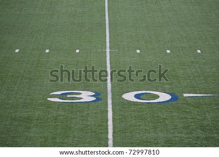 Mark of 30 yards on the field for college football. - stock photo