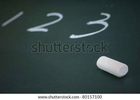 mark on blackboard - stock photo