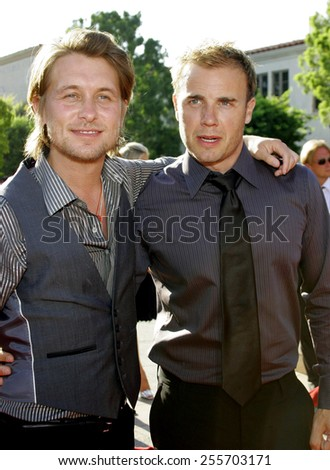 """Mark Owen and Gary Barlow of 'Take That' attend the Los Angeles Premiere of """"Stardust"""" held at the Paramount Pictures Studios in Hollywood, California, on July 29, 2007.  - stock photo"""