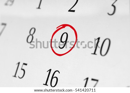 Mark the date number 9. The day of the month is marked with a red circle and focus point on the marked number.