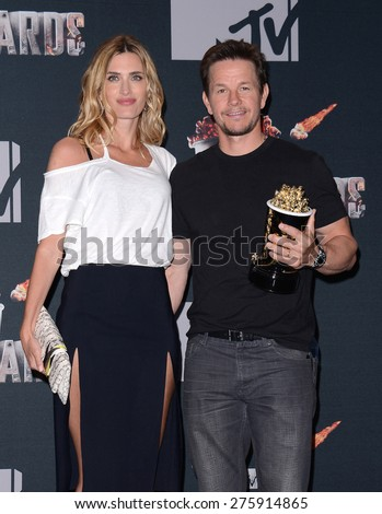 Mark Wahlberg and Rhea Durham at the 2014 MTV Movie Awards - Press Room held at the Nokia Theatre L.A. Live in Los Angeles on April 13, 2014 in Los Angeles, California.