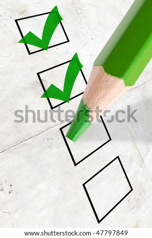 marked check boxes and big green pencil