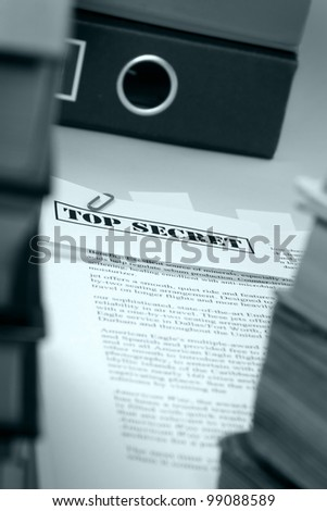 """Marked """"top secret"""" on a pile of documents - stock photo"""