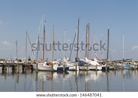 MARKEN - JULY 15: The small marina of Marken is a well-known tourist spot in the Netherlands, on July15, 2013. - stock photo