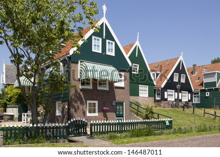 MARKEN - JULY 15: These traditional wooden houses are a well-known tourist attraction on the former island of Marken in the Netherlands, on July 15, 2013. - stock photo