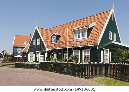 MARKEN - JULY 15: This traditional wooden house is an example of the historic buildings that can be found on the former island of Marken in the Netherlands, on July 15, 2013. - stock photo