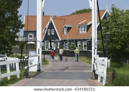 Marken, The Netherlands - June 6, 2013: Typical wooden houses on the former isle of Marken in the Netherlands.