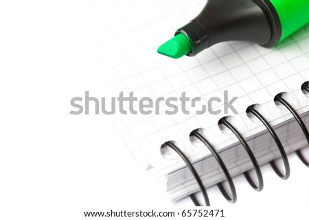 marker and notepad isolated on white