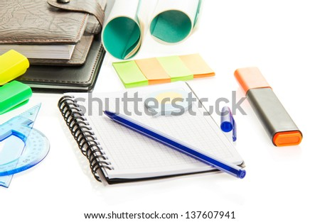 Marker, exercise book, the handle, leaflets for notes and the diary isolated on white