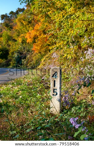 Marker post 415 on the Blue Ridge parkway in autumn in Pisgah Forest in North Carolina - stock photo