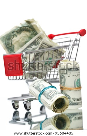 Market cart with money. Focused on money - stock photo