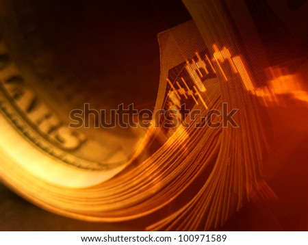 Market data and rolled dollars. Finance concept. - stock photo