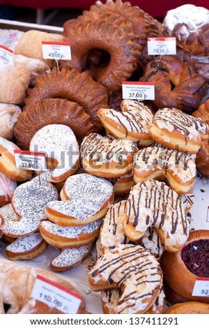 Market. Fresh donuts and buns. - stock photo