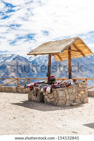 Market, Hawkers in Colca Canyon, Peru, South America  Colorful blanket,  scarf, cloth, ponchos from   wool of alpaca, llama - stock photo