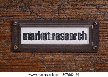 market research - a label on a grunge wooden file cabinet