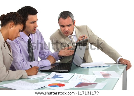 Market researchers working on a project - stock photo