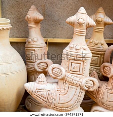 market sale manufacturing container in    oman muscat the old pottery dagger - stock photo
