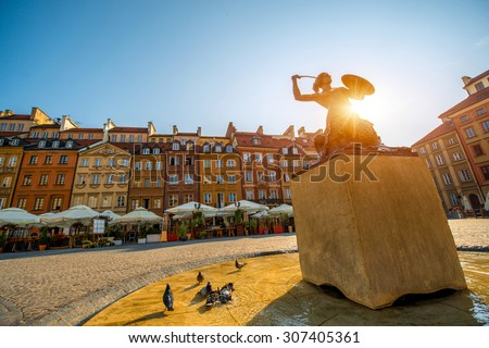 Market square with fountain on a beautiful sunny morning in Warsaw, Poland - stock photo
