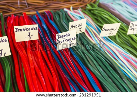 Market stall full of candys in Poland. - stock photo