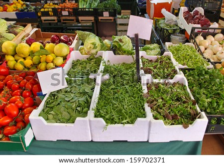 Market stall with fresh organic green vegetables