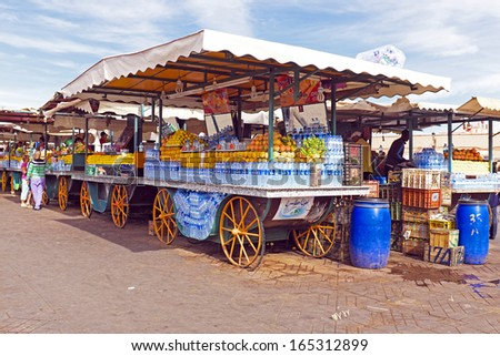 Market stall with fruits on the Aa el Fna square and market place in Marrakesh's medina quarter in Morocco - stock photo