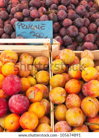 Market stall with plums in Italy