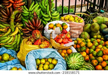Market stall with tropical fruits - stock photo