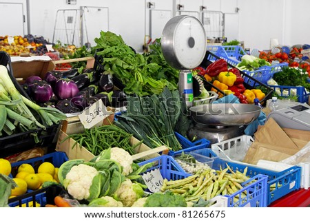 Market stall with vegetables and fruits with scale - stock photo