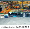 Market stalls with variety of organic vegetables and fruits - stock photo