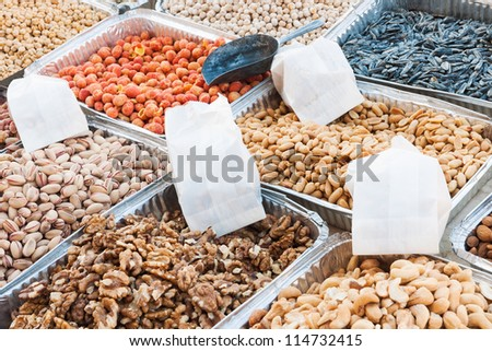 Market stand from which a variety of dried fruit is sold - stock photo