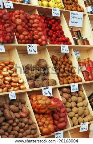 market stand with fruits and vegetables