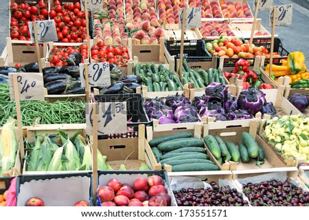 Market with vegetables and fruits for sale on the street in a tent - stock photo