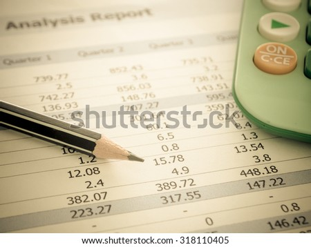 Marketer's desk with analysis Report ,Calculator, pencil. - stock photo