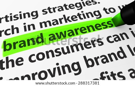 Marketing and advertising concept with a 3d rendering of brand developing strategies related words and brand awareness text highlighted with a green marker. - stock photo