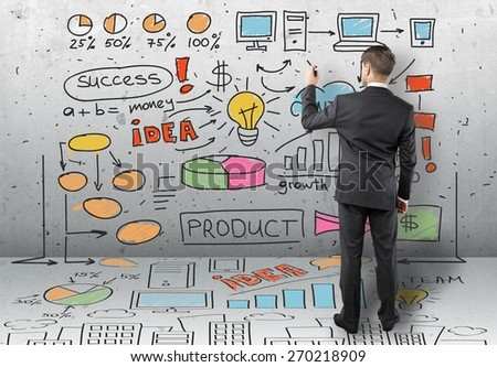 Marketing. Businessman drawing colorized global concept on wall - stock photo