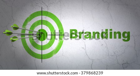 Marketing concept: target and Branding on wall background - stock photo