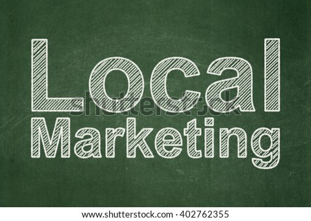 Marketing concept: text Local Marketing on Green chalkboard background